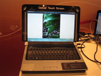 A Dell notebook that features Quanta's Optical Touch Screen