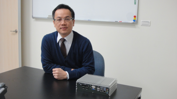 Vecow CEO Eric Yu with the company's ECS-7000 series embedded system boasting a wide temperature range and fanless design.
