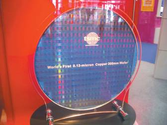 TSMC showcases world's first 0.13-micron wafer