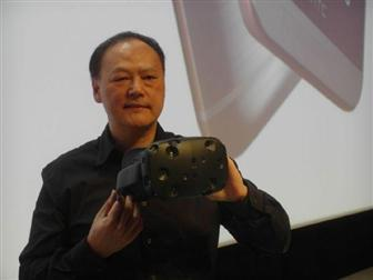 HTC CEO Peter Chou demonstrates the HTC Vive