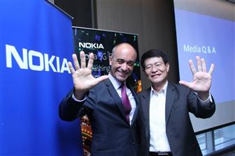 Nokia+chief+architect+Volker+Ziegler+%28left%29+and+Nokia+Greater+China+president+Mike+Wang