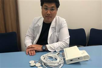 Heroic Faith Medical president Fushun Hsu with a chest sound monitor