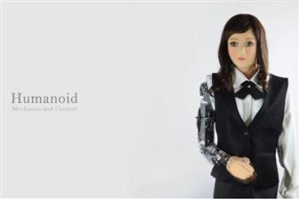 A humanoid baccarat dealer robot developed by TIRC